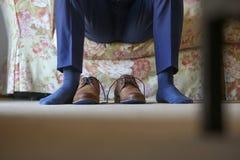 Zapatos de un novio Fotos de archivo