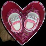 Zapatos del caramelo del bebé Fotografía de archivo