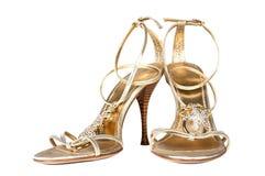 Zapatos del color del oro fotografía de archivo