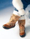 Zapatos del invierno en nieve Fotografía de archivo