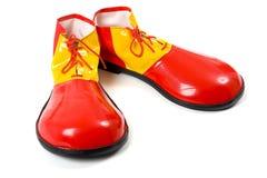 Zapatos del payaso en blanco foto de archivo libre de regalías