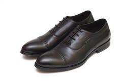 Zapatos en el fondo blanco Fotos de archivo