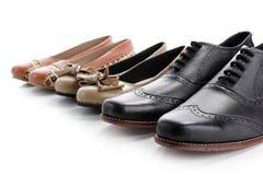 Zapatos en fila en blanco Imágenes de archivo libres de regalías