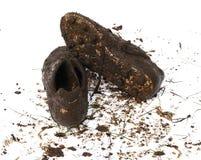 Zapatos fangosos del balompié Foto de archivo