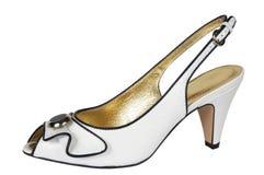 Zapatos femeninos blancos Fotografía de archivo libre de regalías