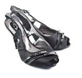 Zapatos femeninos de cuero negros Fotos de archivo libres de regalías