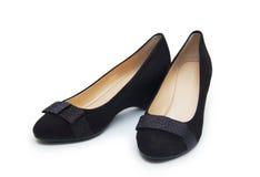 Zapatos femeninos en un fondo blanco Foto de archivo