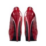 Zapatos femeninos rojos con los tacones altos fotos de archivo