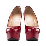 Zapatos femeninos rojos con los tacones altos Fotografía de archivo libre de regalías