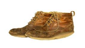 Zapatos marrones viejos aislados foto de archivo