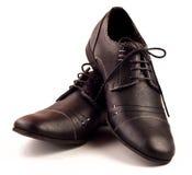 Zapatos masculinos negros sobre blanco Imagen de archivo libre de regalías