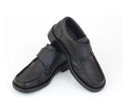 Zapatos negros de los hombres aislados en el fondo blanco Foto de archivo libre de regalías