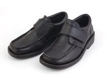 Zapatos negros de los hombres aislados en el fondo blanco Imagen de archivo