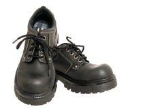 Zapatos negros del invierno de las mujeres Foto de archivo