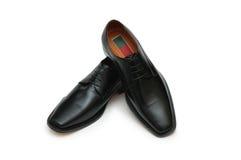 Zapatos negros masculinos aislados en t imágenes de archivo libres de regalías