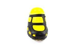 Zapatos negros y amarillos de la casa Imagen de archivo