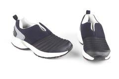 Zapatos negros y blancos de los deportes imagen de archivo libre de regalías
