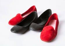 Zapatos negros y rojos Imagen de archivo