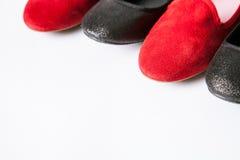 Zapatos negros y rojos Imágenes de archivo libres de regalías