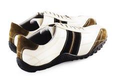 Zapatos ocasionales en blanco Fotos de archivo