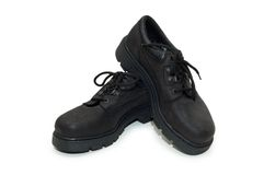 Zapatos resistentes aislados en el fondo blanco Imagen de archivo libre de regalías