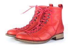 Zapatos rojos con los cordones Foto de archivo
