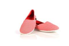 Zapatos rojos de las mujeres aislados en el fondo blanco Foto de archivo libre de regalías