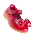 Zapatos rojos para los bebés en fondo Imágenes de archivo libres de regalías