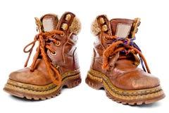 Zapatos usados de los niños Fotografía de archivo