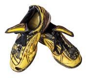 Zapatos viejos del fútbol Fotos de archivo