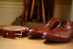 Zapatos y correa Fotografía de archivo