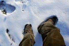 Zapatos y nieve Imágenes de archivo libres de regalías