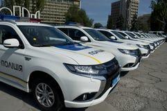 ZAPORIZHIA, UKRAINA Czerwiec 6, 2017: Mitsubishi samochody policyjni przy solenną ceremonią na kwadracie w ZAPORIZHIA, UKRAINA Zdjęcie Stock
