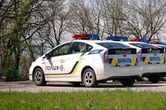 ZAPORIZHIA, UKRAINE - APRIL 16, 2016: Ukrainian police cars at the ceremony of taking an oath by the members of the new patrol pol Stock Photos