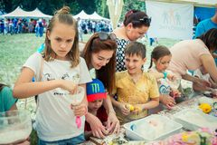 Children and their parents participating at anti-stress toy creation workshop. Zaporizhia/Ukraine- June 2, 2018: children and their parents participating at anti royalty free stock images