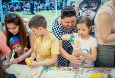 Children and their parents participating at anti-stress toy creation workshop. Zaporizhia/Ukraine- June 2, 2018: children and their parents participating at anti stock photo