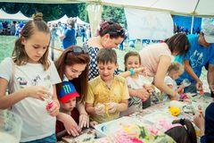 Children and their parents participating at anti-stress toy creation workshop. Zaporizhia/Ukraine- June 2, 2018: children and their parents participating at anti royalty free stock image