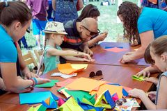 Hildren and their parents participating at arts and craft outdoors workshop royalty free stock image