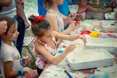 Girls participating at anti-stress toy creation workshop. Zaporizhia/Ukraine- June 2, 2018: girls participating at anti-stress toy creation workshop, filling stock photography