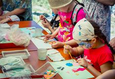 Children creative activity at charity Family festival. Zaporozhia/Ukraine- June 2, 2018: Charity Family festival –children and their parents royalty free stock image