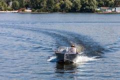 ZAPOROZHYE, UKRAINE-AUGUST 11: Motorboat11, 2012 in Zaporozhye. Ukraine. Motorboat on the Dnieper River on the background of the island Khortytsya near the stock photography