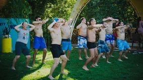 Zaporozhye, Ukraine-August 2018 pool party in the company ovoh, Just dance a group of young men dancing together and looking happy stock photos