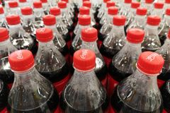 Zaporozhye Ukraine - July 20, 2018. Close up of Coca Cola soft drinks bottles. Coca Cola drinks are produced and manufactured by T. He Coca-Cola. Plastic bottles stock photos