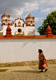 Zapotec Woman passing Teotitlán Church, Mexico Stock Image