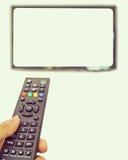 Zapping con telecomando Immagine Stock