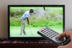 Zapping tv during golf Royalty Free Stock Photo