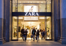 Zara store. Customers walking out of a Zara shop located on Passeig de Gracia, in Barcelona, Catalunya Royalty Free Stock Photo