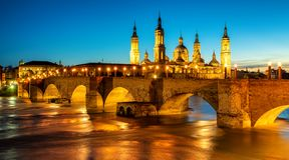Zaragoza city, Spain, bridge and Cathedral del Pilar at sunset