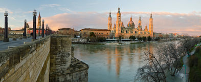 Zaragoza Panorama and Ebro river  in early morning lights. Panorama of Basilica–Cathedral of Our Lady of the Pillar Ebro river in early morning lights before Stock Images