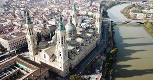 Aerial view of Roman Catholic Basilica Our Lady of Pillar on background of Zaragoza cityscape and Ebro river, Spain